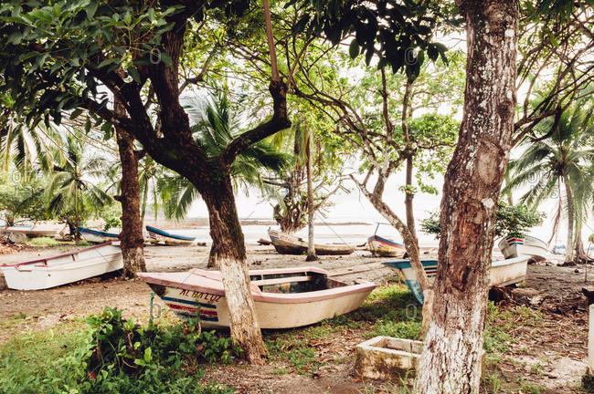 Nosara, Costa Rica - October 23, 2012: Boats on Costa Rican beach