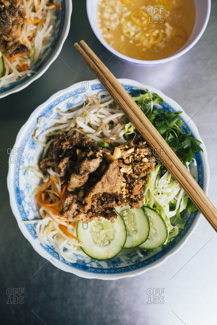 Bun thit nuong, rice noodles with grilled pork and fresh herbs
