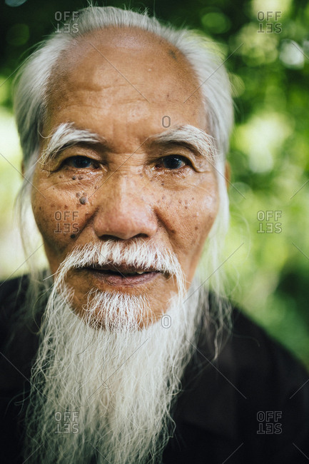Hanoi, Vietnam - August 3, 2016: A portrait of an older Vietnamese man