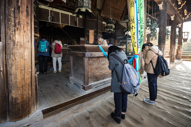 Nara, JAPAN - December 18, 2016: People praying at Nigatsudo hall of Todaiji temple.