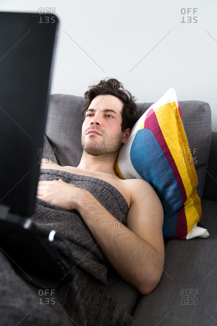 Man using laptop while reclining