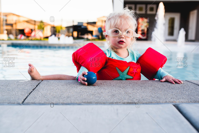 Blonde toddler in a swimming pool