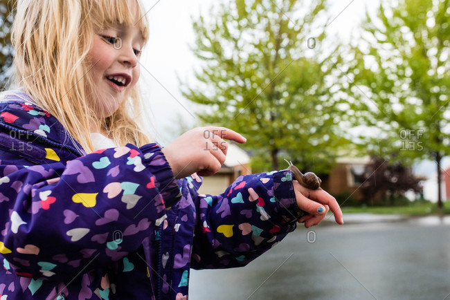 Excited girl  holding a snail