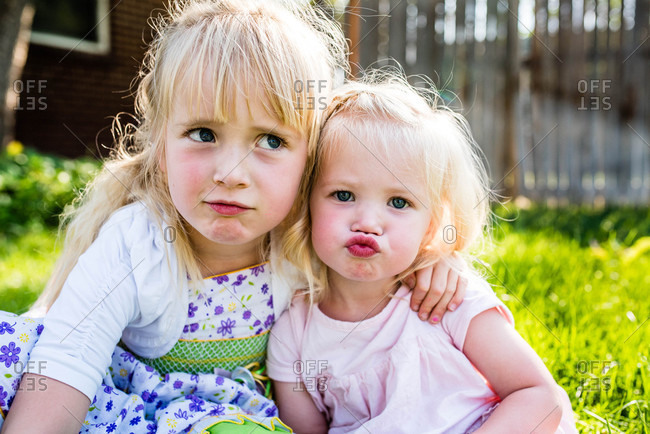 Two little girls making silly faces