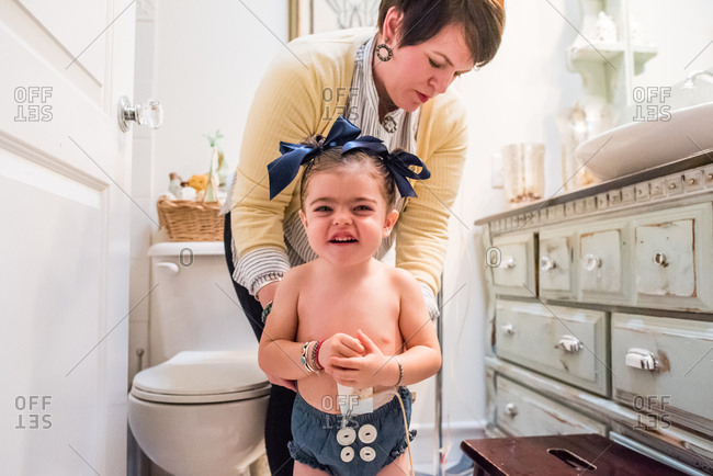 Mother getting daughter ready in the bathroom