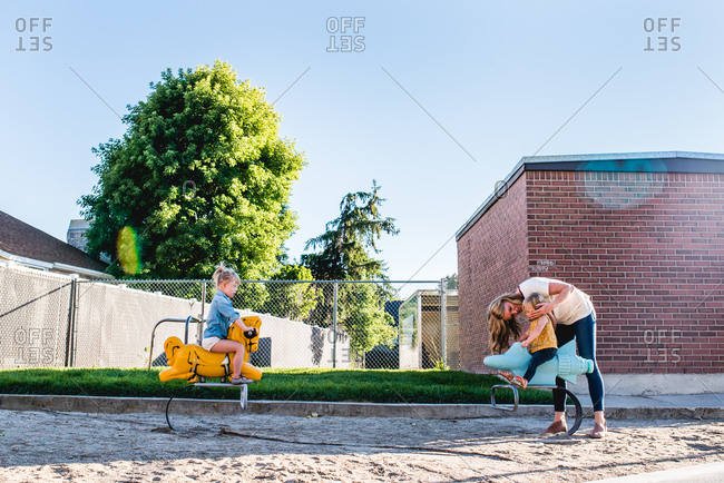 Mother and daughters playing at a park