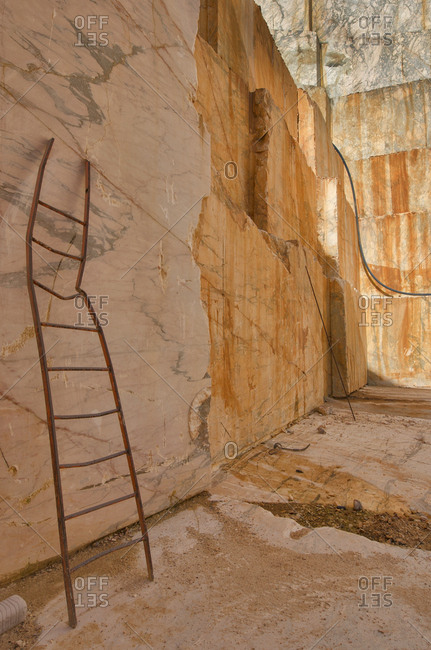 Bent ladder in marble quarry