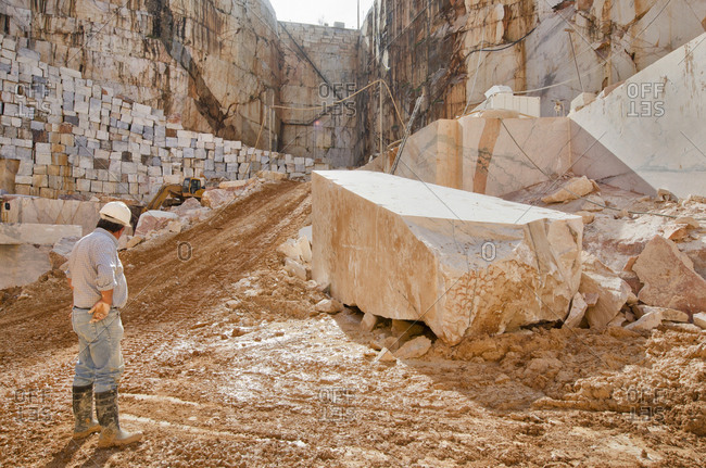 Alentejo, Portugal - October 21, 2014: Man standing in marble quarry