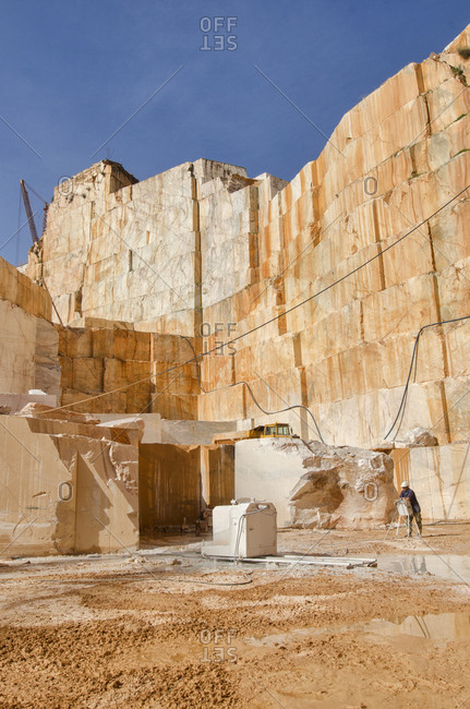 Alentejo, Portugal - October 21, 2014: Man standing in deep marble quarry