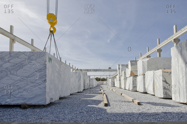 Alentejo, Portugal - October 21, 2014: Crane stacking marble blocks