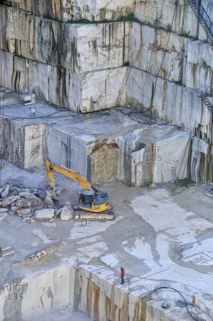 Alentejo, Portugal - October 21, 2014: Excavator machine in marble quarry