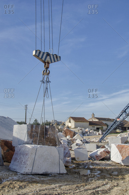 Marble blocks being lifted by crane