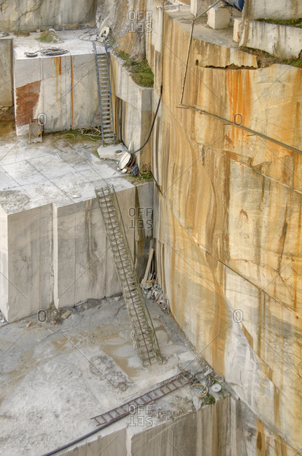 Ladders going into marble quarry