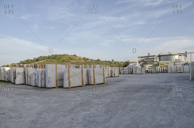 Slabs of marble in outdoor storage