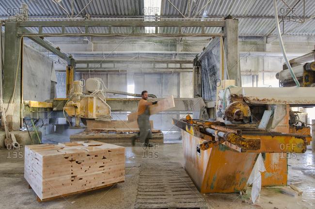 Alentejo, Portugal - October 21, 2014: Man working in marble factory
