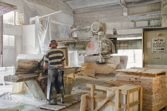 Alentejo, Portugal - October 21, 2014: Man working in a marble plant
