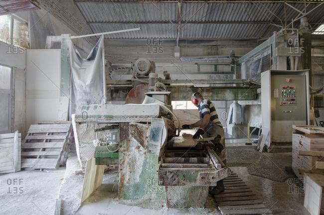 Alentejo, Portugal - October 21, 2014: Man working inside a marble plant