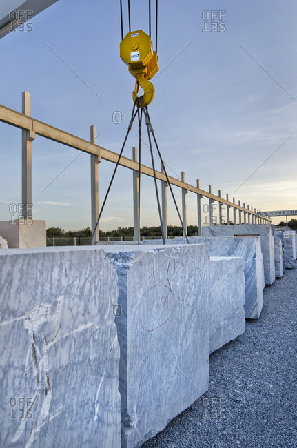Alentejo, Portugal - October 21, 2014: Crane lifting slabs of marble