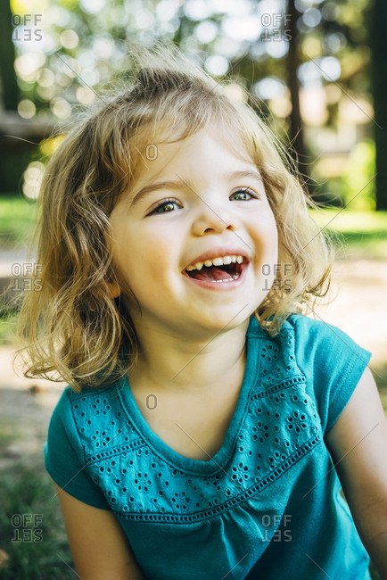 Portrait of laughing Caucasian preschool girl