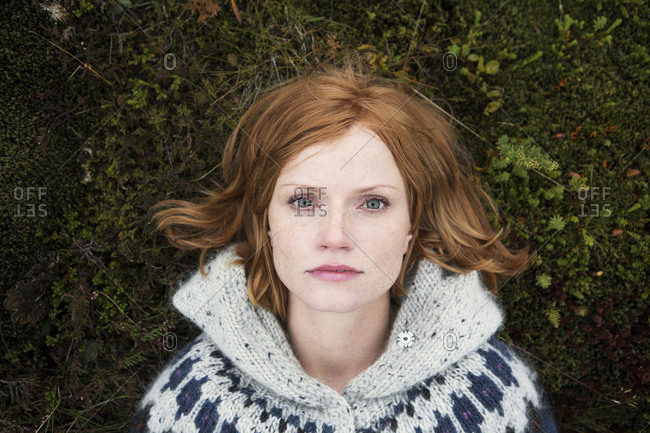 Portrait of Caucasian woman laying on moss