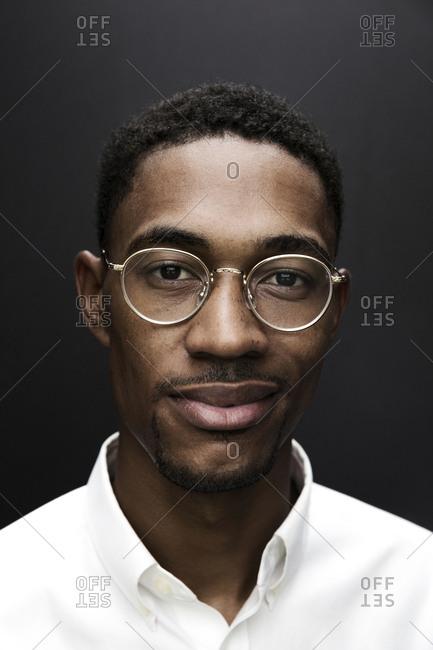 Portrait of smiling Black man wearing eyeglasses