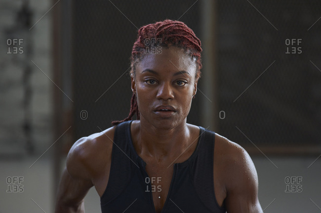 Portrait of serious Black woman sweating