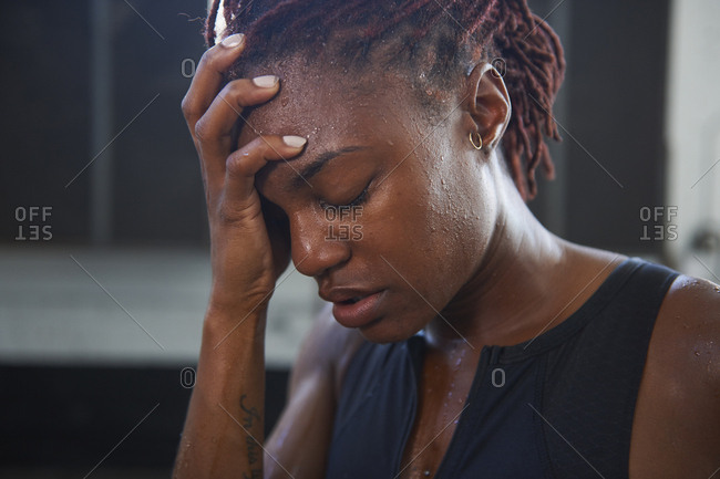 Portrait of frustrated Black woman sweating