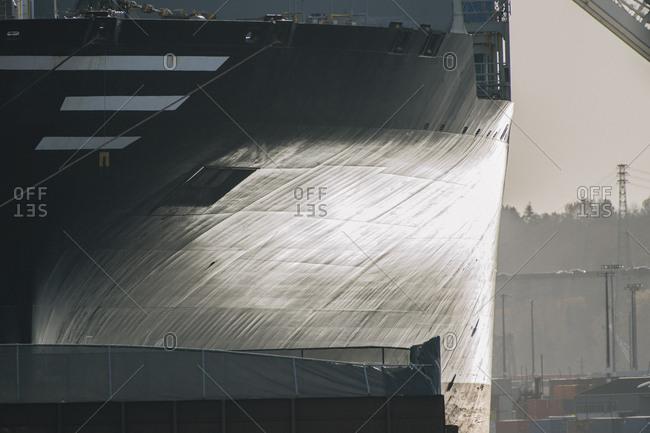 Hull of ship at shipping port