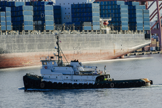 Tugboat in harbor at shipping port