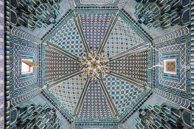 Samarkand, Samarkand, Uzbekistan - November 12, 2016: Open window in ornate ceiling