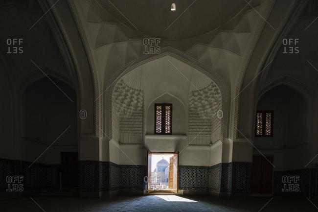 Samarkand, Samarkand, Uzbekistan - November 12, 2016: Distant doorway in ornate mausoleum