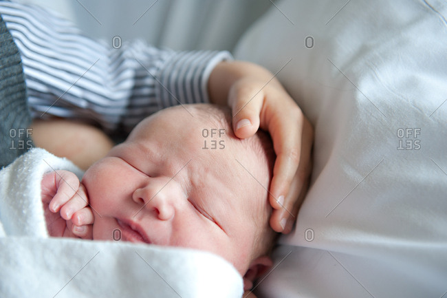 Child holding infant sibling