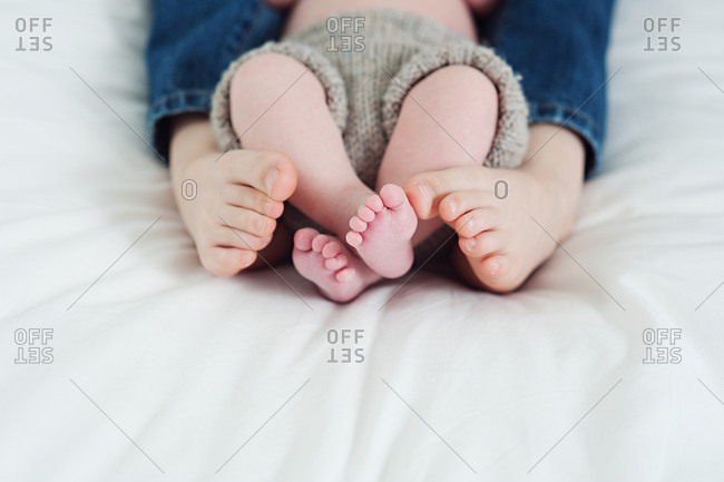 Close up of the feet and legs of two young brothers