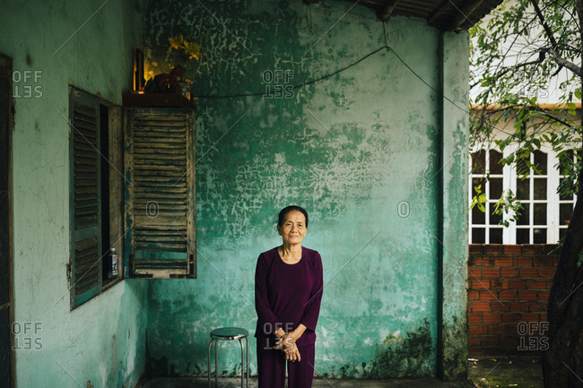 Hoi An, Vietnam - January 15, 2017: A portrait of an older woman in a small village in Hoi An, Vietnam.