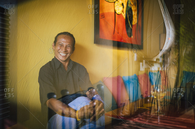 Hoi An, Vietnam - January 15, 2017: A portrait of chef Duc Tran at his flagship restaurant, Mango Mango, in Hoi An, Vietnam.