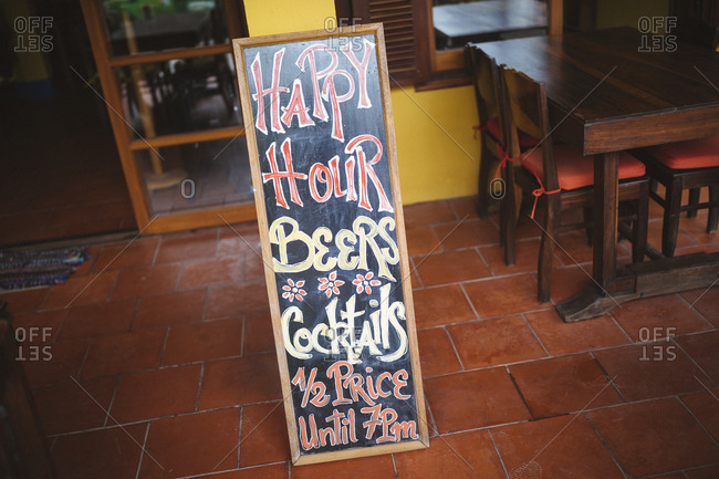 A Happy Hour sign at a restaurant in Hoi An, Vietnam.