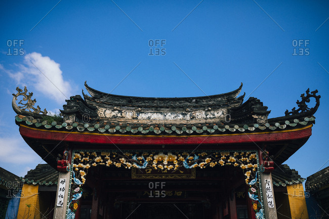 Hoi An, Vietnam - January 17, 2017: A detail of a temple rooftop in the Old Town of Hoi An in central Vietnam.