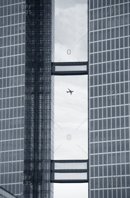 Passenger jet plane seen through opening in office building in Munich, Germany