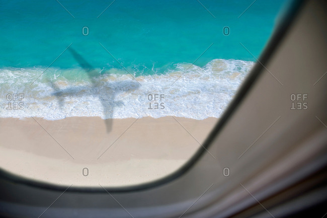 Shadow of passenger jet plane approaching airport in Nassau, Bahamas