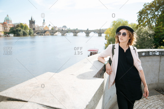 Trendy young woman by Vltava river, Prague