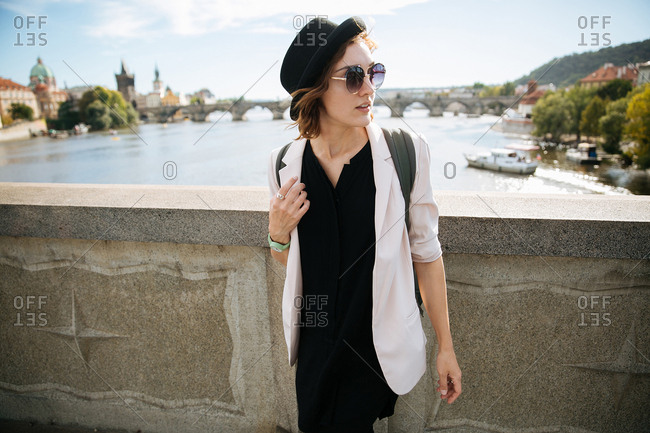 Trendy woman by Vltava river, Prague