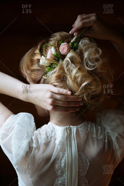 Blonde bride with flowers in hair