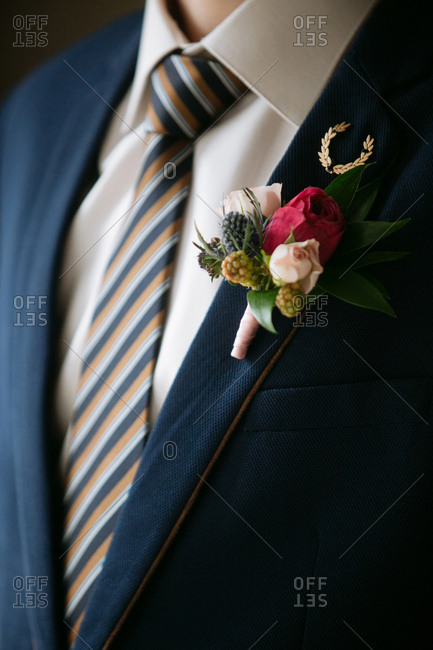 Groom in striped tie with boutonniere