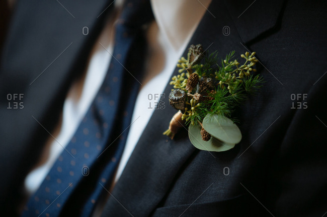 Groom wearing pine boutonniere