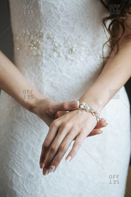 Bride putting on a bracelet