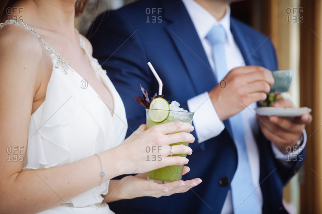 Bride and groom with drinks in hands