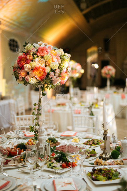 A wedding reception table with food