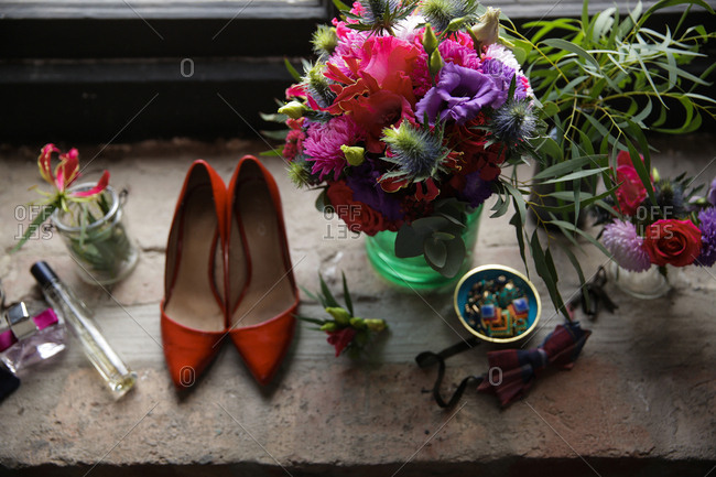 Shoes and flowers on window ledge
