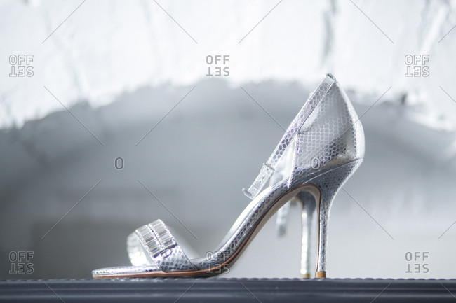 Single silver high heeled shoe
