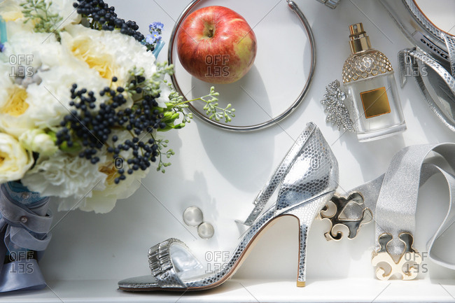 Various items with high heeled shoe